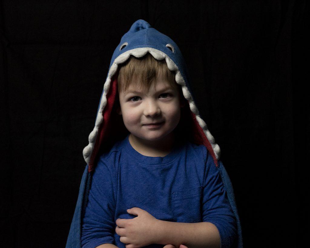 Boy in shark character jacket